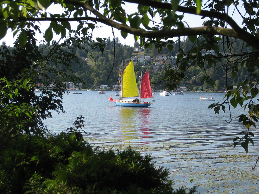 Historic wooden gaff-rigged ketch, Sailing Vessel Bimi making her way across Lake Washington.