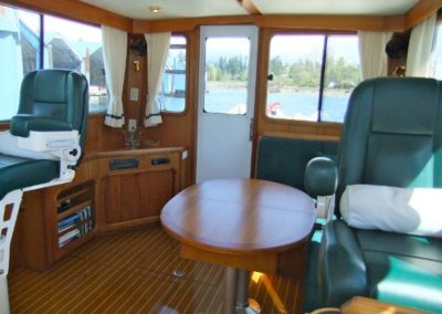 Splendido cabin with rich wood interior and leather captains chairs