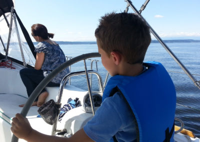 Even the little man can give it a go - Seattle Sailing Charters fun!